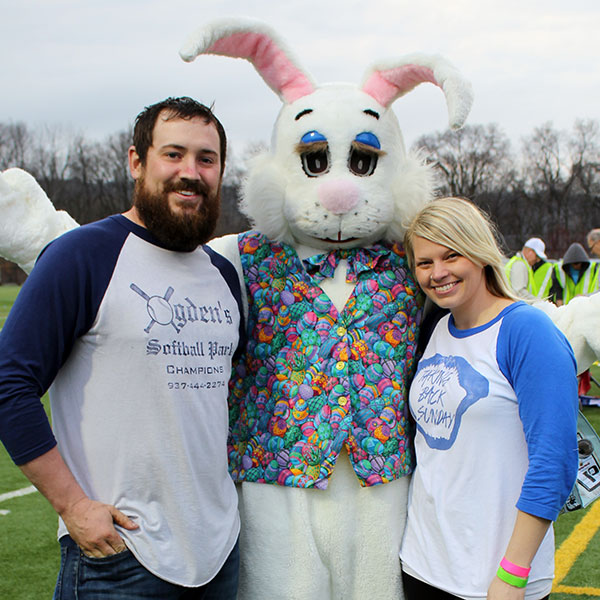 couple hugs the easter bunny at Adult Egg Hunts