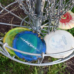 disc golf discs in basket