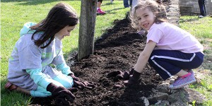 young girls mulching at Johnson Hills Park during Great American Cleanup