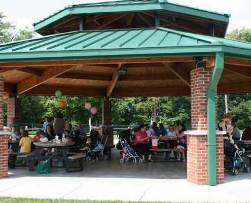 Park guests dining at Beech Acres Park Shelter #1. Shelter can seat 66 and includes 11 tables