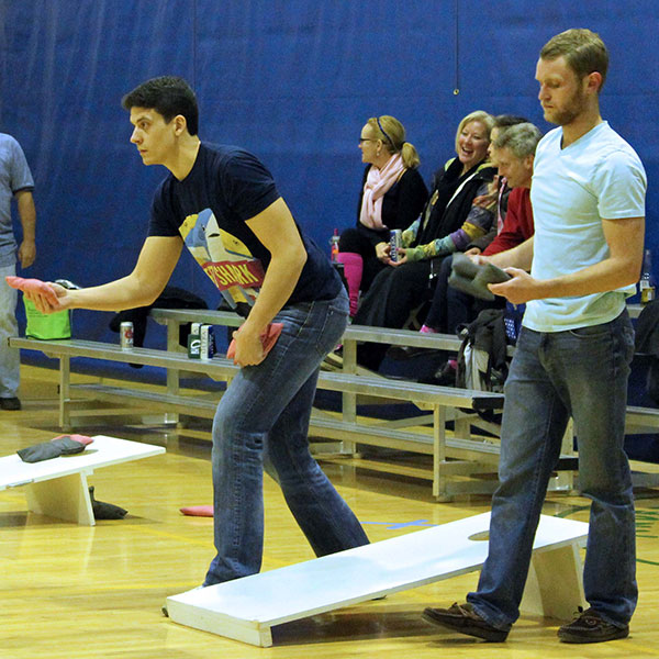 Adults playing in the adult co-rec cornhole league