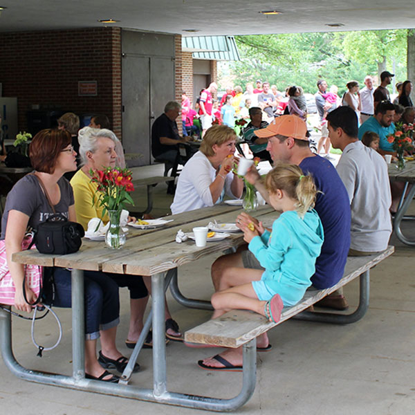 Guests enjoying breakfast at Pancakes in the Park while dining at the Beech Acres Park RecPlex patio