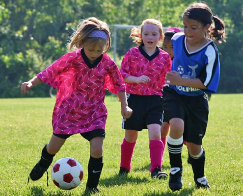 girls playing soccer at Beech Acres Park