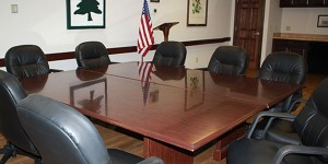 Juilfs Park board room with table and black executive chairs