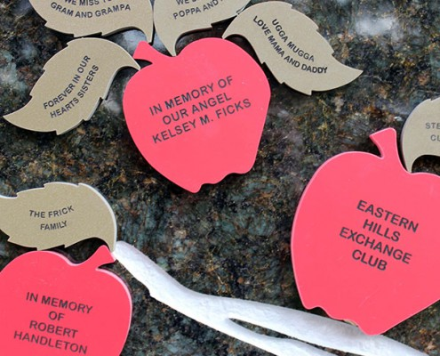 Lasting gifts: Juilfs Park Apple of Your Eye tribute tree with engraved apples and leaves
