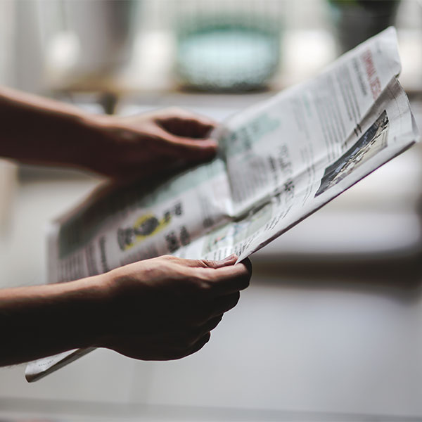 person reading the paper about an article on the park district