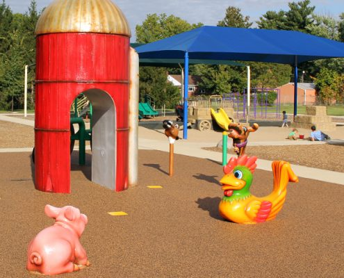 The water play area completes the well-received playground renovation and continues the playground's farm theme with these features: a pig, rooster, horse, sheep and bull aqua sprayers; trickle tractor; and silo aqua sprayer.