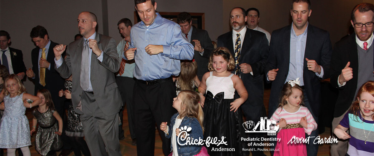 dads and daughters at the annual daddy daughter dance