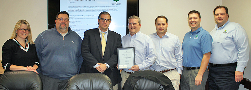 park board with park Financial Officer displaying the received award from the Government Finance Officers Association
