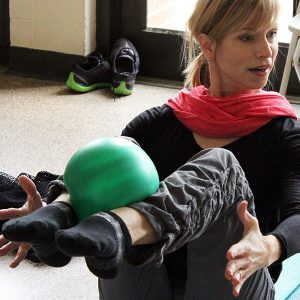 Pilates Mat Mix instructor teaching a class