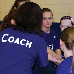 basketball coach talking to her team