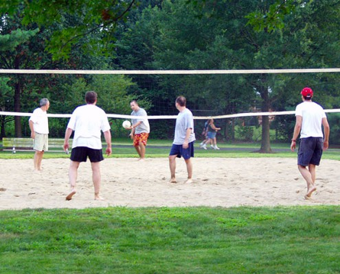 Adult men playing a game on the Juilfs Park Sand Volleyball Courts