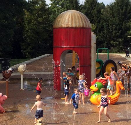 group of children enjoying the water play area at juilfs park