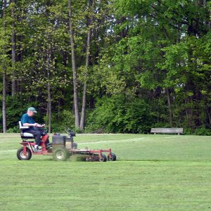 park district employee mowing grass