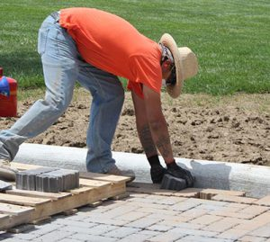 worker installing Permeable Pavers at Clear Creek