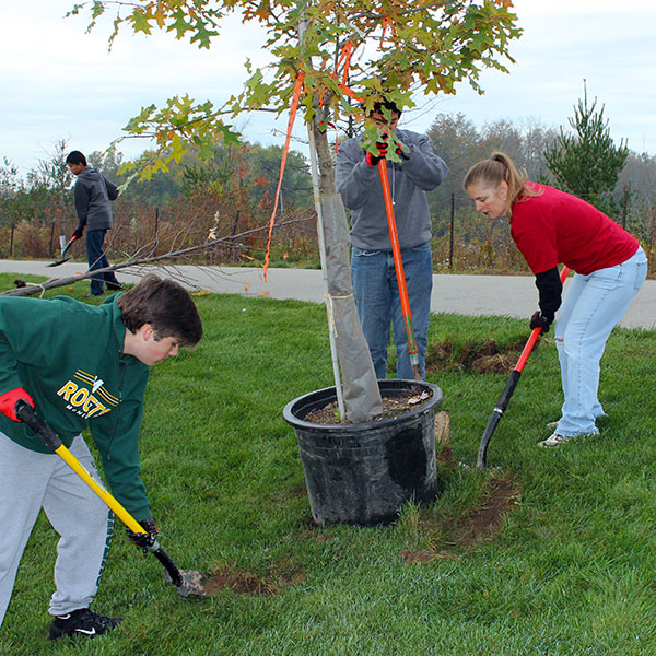 Volunteers at Make A Difference Day planting trees at Riverside Park