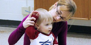 Mom and son learning sign language during Sing and Sign