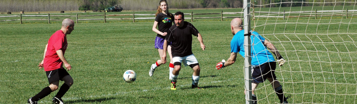 Park district's 11v11 co-rec soccer players at Clear Creek Park. Soccer players trying to score a goal