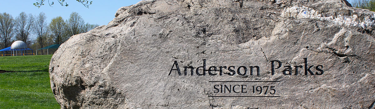 large boulder at Juilfs Park entrance that reads 'Anderson Park Since 1975""