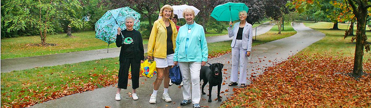 women walking on juilfs park trail in the fall