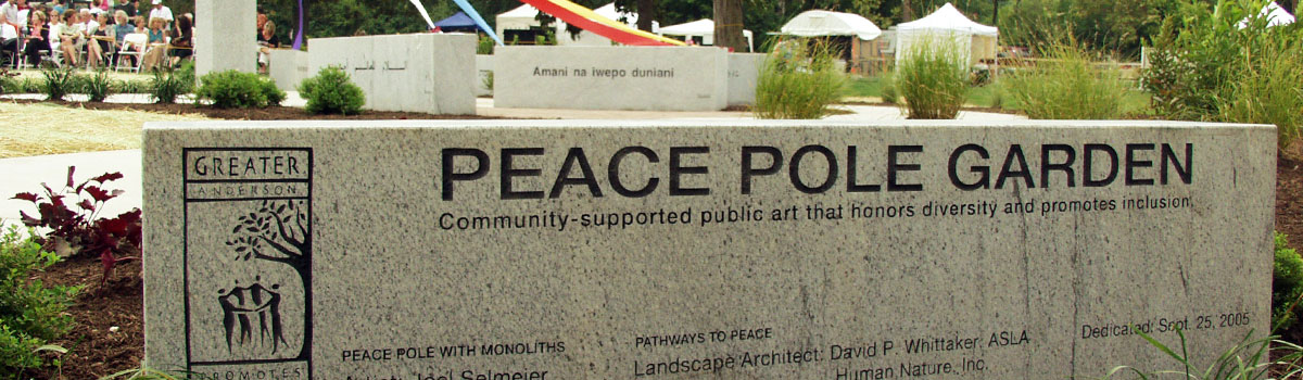 "There are 12 different translations of ""May Peace Prevail on Earth"" inscribed on six stone monoliths surrounding a smooth 9-ft. granite pole."