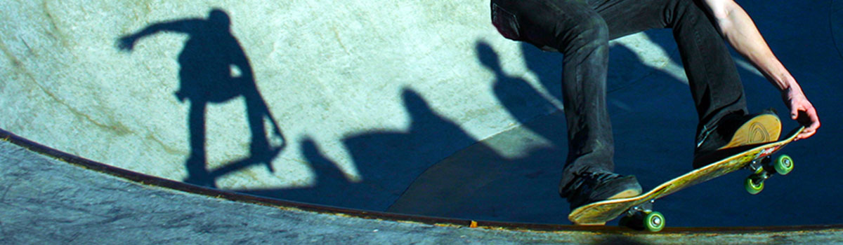 Close up of skateboarder's feet and board at the Beech Acres Park Skatepark