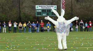 easter bunny stands in front of the crowd at the adult hunt