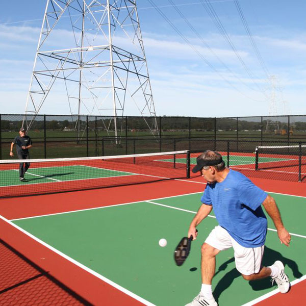 men playing pickleball on the Pickleball Courts