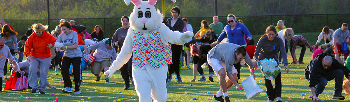 bunny running away from the crowd during the adult egg hunt