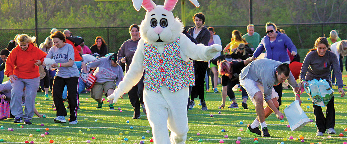 Easter Bunny running to avoid getting trampled during an adult egg hunt