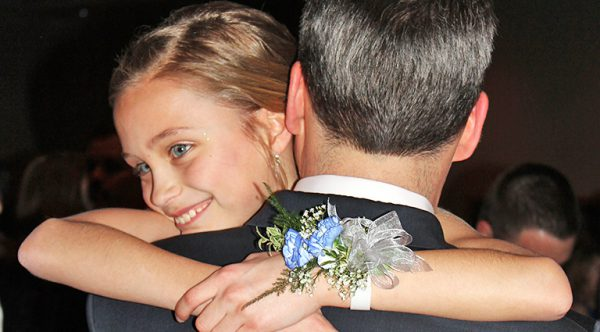 daughter dancing with dad at annual daddy daughter dance