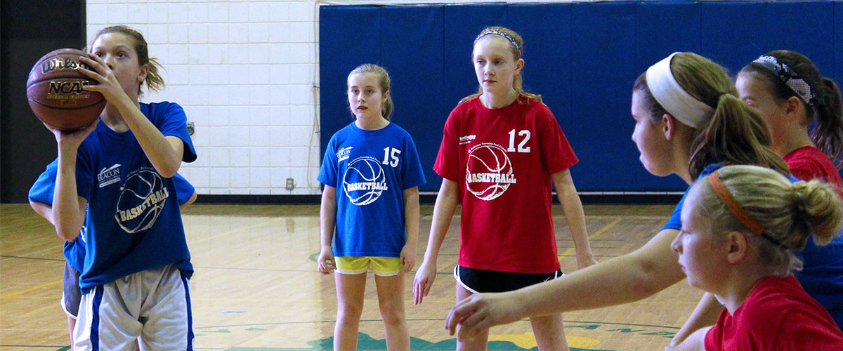Girls grades 3-6 playing basketball in the Anderson Parks RecPlex gym