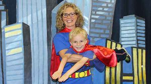 mother and son dressed as superheroes for mother-son superhero dance
