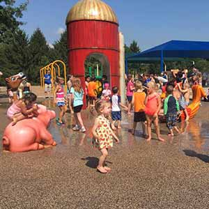 kids playing in the water play area at juilfs park playground