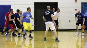 men over 35 and up playing basketball