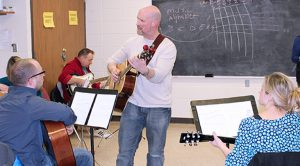 adults learn to play guitar