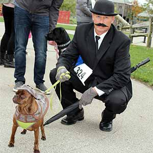 dog and owner dressed in costume for howlaween parade