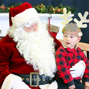 child sitting on santa's lap at Santa's Workshop at the Anderson Parks RecPlex
