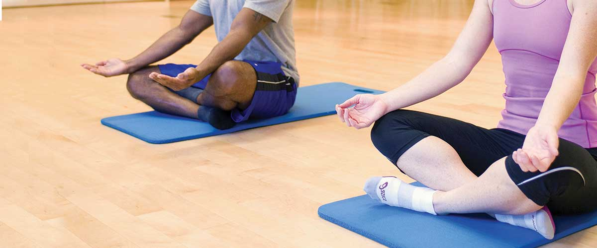 man and woman in yoga pose
