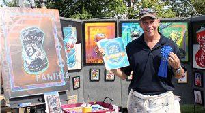 a fair of the arts best of show winner holding blue winner