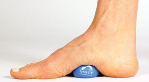 MELT® Hand & Foot Treatment with foot using a ball