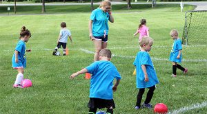 kids participating in kickers, instructional program to learn soccer