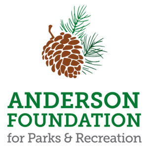 new logo for anderson foundation for parks and recreation with an acorn and pine needles