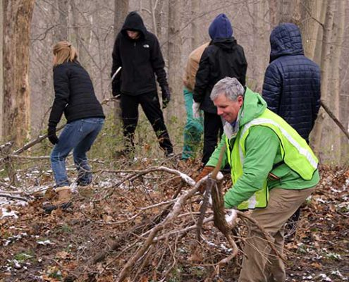 volunteers working on various projects during the great american cleanup day at johnson hills park