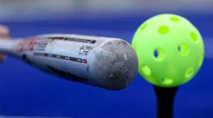 close up of bat and ball. instructional sports t-ball