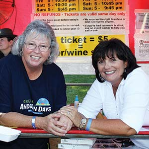 volunteers having fun while working at a beer booth during greater anderson days